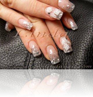 Ноктопластика - изграждане с акрил, с вграден сребрист брокат и на безименните пръсти - релефни цветя с камъчета